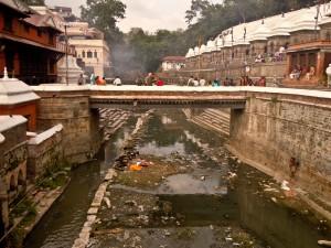 dark and murky Bagmati River in Kathmandu, Nepal