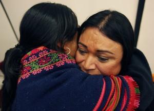 Jennicet Gutierrez and Alicia Garcia hugging.