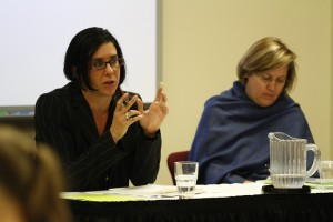 Shayna Plaut speaking in a meeting.