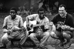 A Ugandan person playing guitar