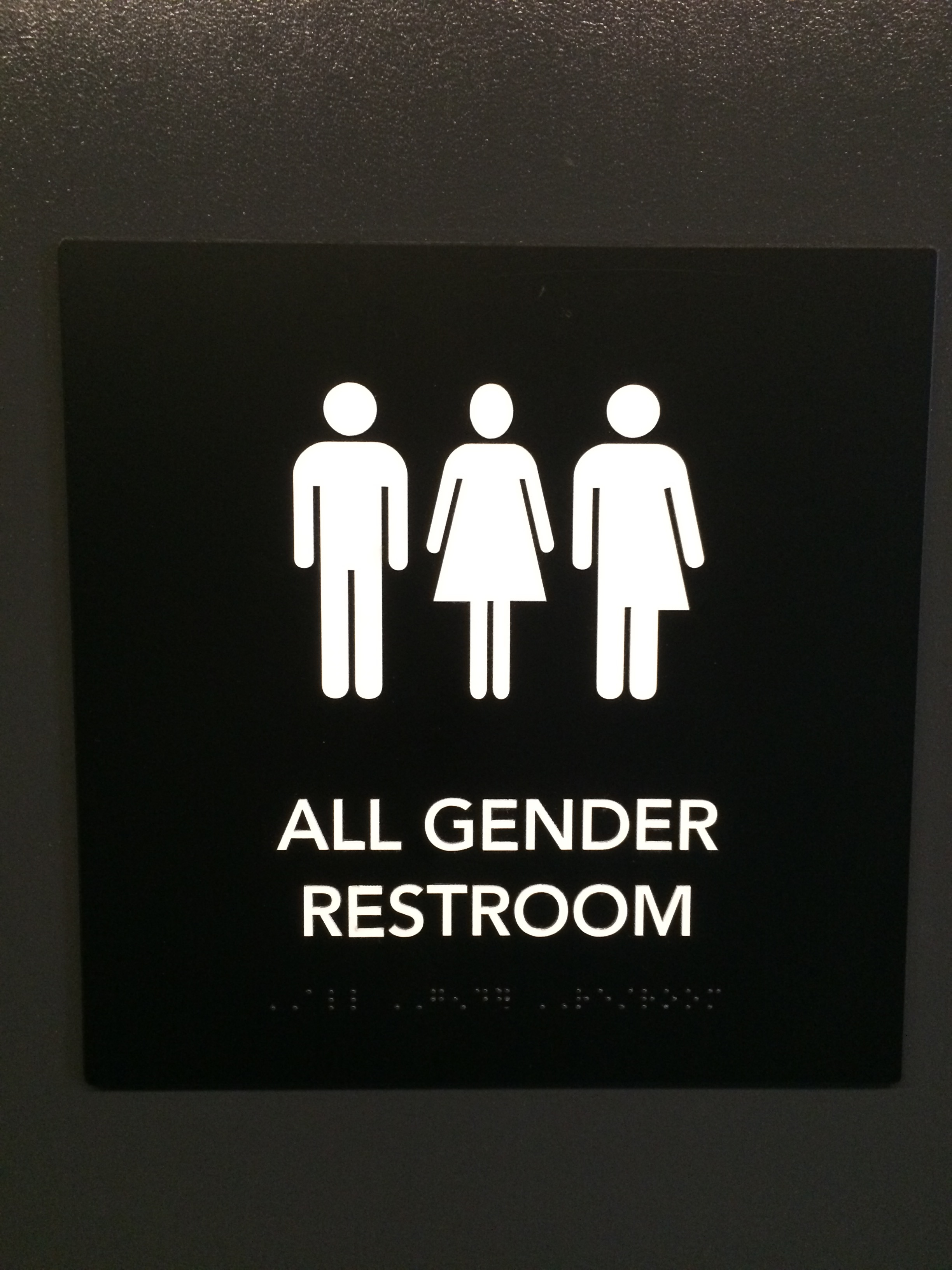 Sign for the all gender restroom at the Arcus Center for Social Justice Leadership