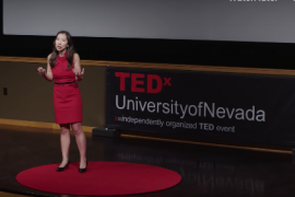 Dr. Lena Wen standing on stage for TEDx