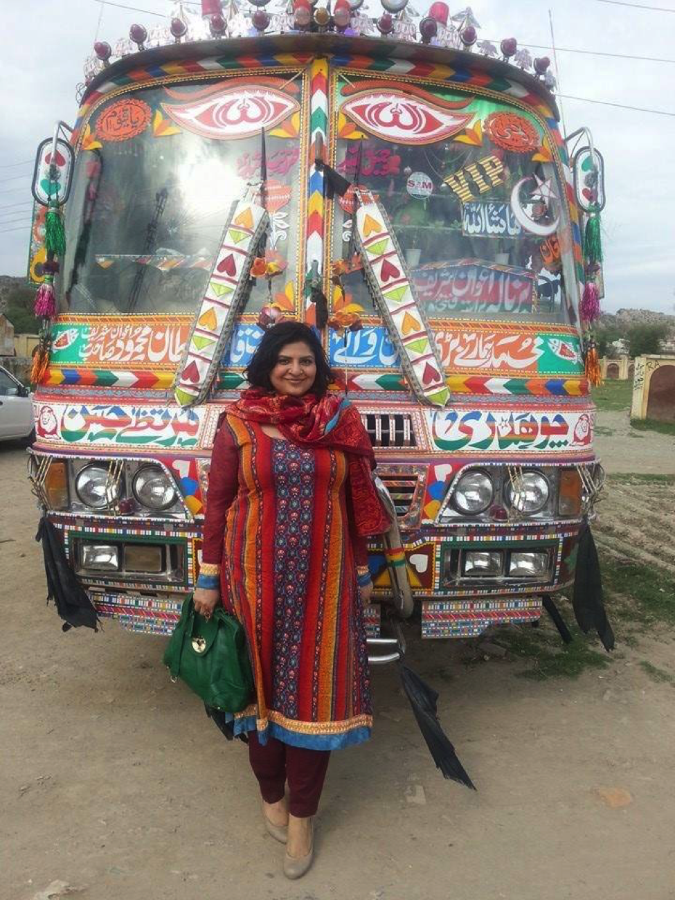 decorated passenger van with woman standing in front