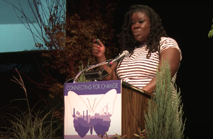 Tanya Fields speaking at podium