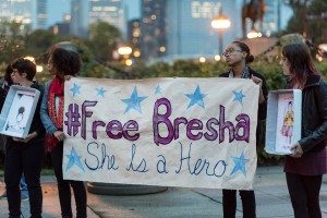 "supporters holding a banner with words ""#FreeBresha She is a Hero"""
