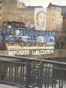 "Street graffiti in Berlin reading ""Refugees Welcome"""