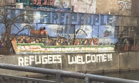 """Wall art reading """"refugees welcome"""""""