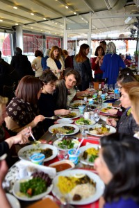 Kirkayak's Kitchen Project. Syrian and Turkish Women share a meal together. Photo by Kemal Vural Tarlan. Reproduced with permission.