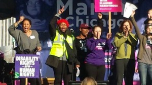 Cheryl Johnson-Odim (left in grey sweater) with other March organizers leading a chant from the stage