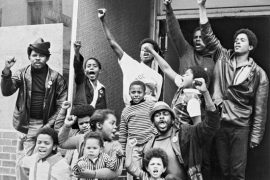 a group of black folks raising their fists in the air
