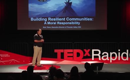 Nick Tilsen on stage at Tedx Rapid City