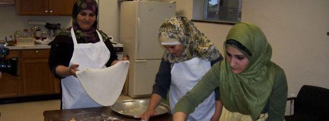 three women in a Yemeni breadmaking class
