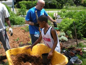 young african american male working in the Lathrup Village Children's Garden