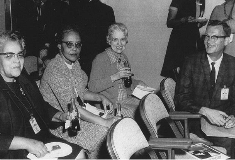 black and white photo of Katherine Johnson, Dorothy Vaughn, Macy Jackson, and John Glenn