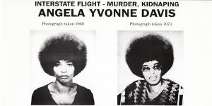 "Wanted poster for Angela Davis, two photos of Davis with caption ""Interstate flight - murder, kidnapping"""