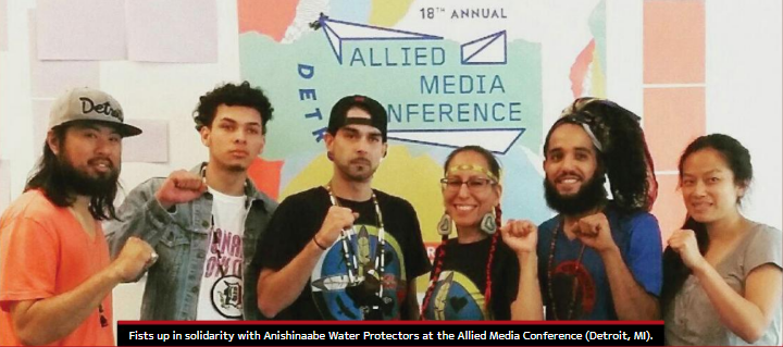 Shane Bernardo and fellow activists raising fists in solidarity with the Anishinaabe Water Protectors