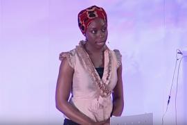 Chimamanda Ngozi Adichie speaking on a stage