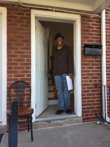 Zolo Azania standing in a doorway smiling