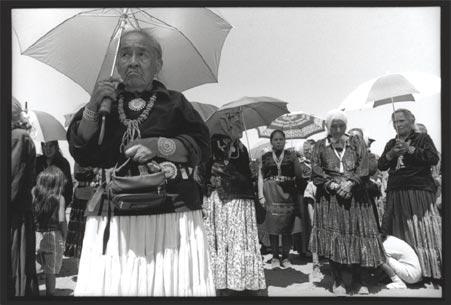 Black and white photograph of Navajo women holding umbrellas
