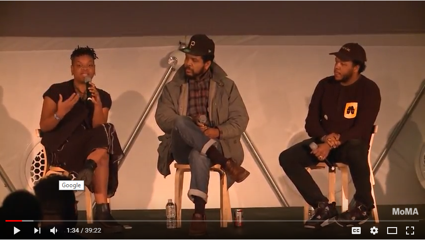 Ephraim Asili, Amir George and Erin Christovale sitting on stools on stage