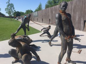 Nkyinkyim Sculpture at the National Memorial for Peace and Justice depicting enslaved people in chains