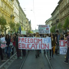 "Protest march in Hungary, sign reading ""Freedom for Education"""