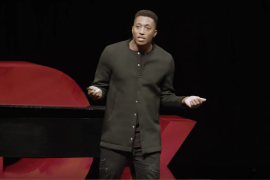 Lecrae speaking onstage at Tedx