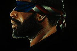 Black man with eyes covered by an American flag bandana, #FreeAmerica