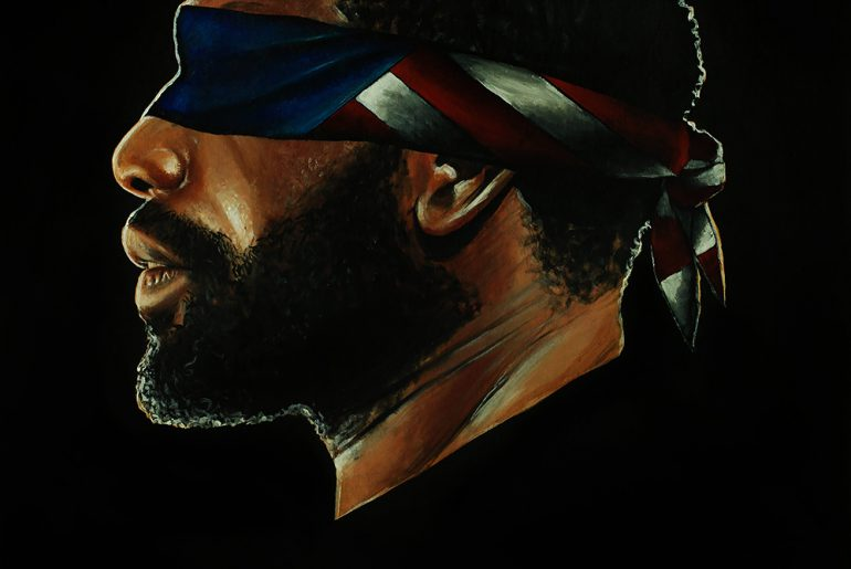 Black man with eyes covered by an American flag bandana, #FreeAmerica