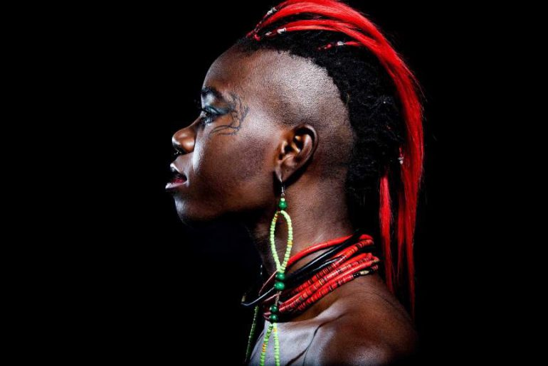 d'bi young anitafrika in profile, black background