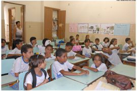 A group of Brazilian children sitting at desks in a classroom