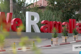 "Sculpture on the street of white and red letters reading ""We Ramallah"""