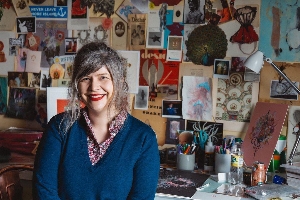 artist Jenny Brown sitting in her studio in Providence