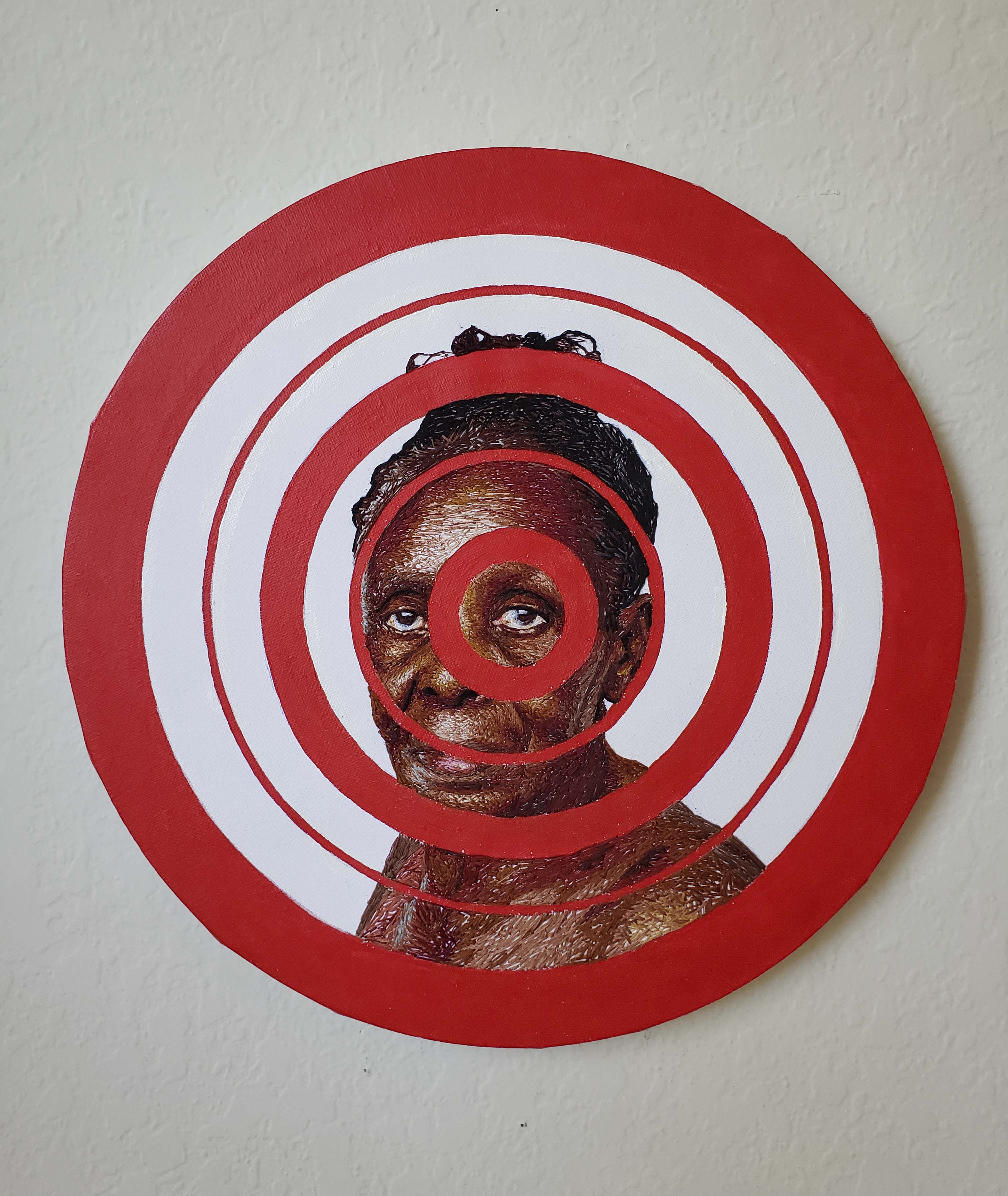 Image of hand embroidered elderly woman, part three of the Targets Variegated series.