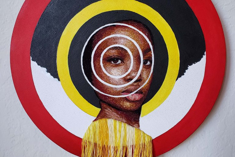Image of hand embroidered portrait entitled Yellow Light from the Targets Variegated Series.