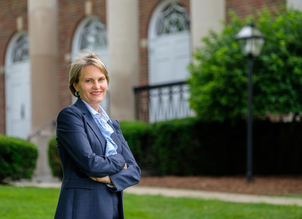Interim Provost Laura Lowe Furge in front of Stetson Chapel