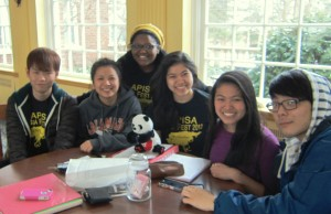 Five international students sitting at a table