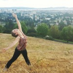 Alexandra Smith '16 stretching near a scenic overlook