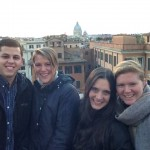 Four smiling K students in Rome