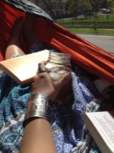 Student reading in a hammock