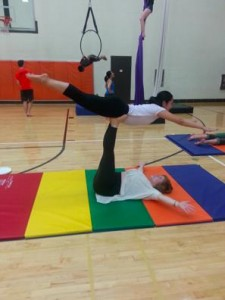 Cirque du K practice featuring two participants in Superman position
