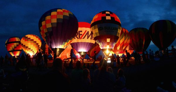 Hot-air balloons at night during the Kalamazoo Balloon Festival
