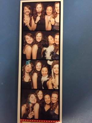 Four women in a photo booth photo