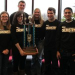 Six Chemistry students and a large trophy