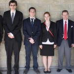 Six formally dressed people