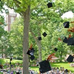 Graduates tossing hats at Commencement