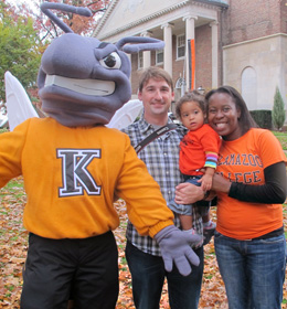 Buzz the Hornet with a family of three at Homecoming