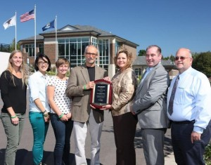 Seven K representatives accept Green Generation Customer of the Year award