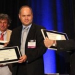 Kalamazoo College Professor Peter Erdi (left), Plamen Angelov (Lancaster University), and Daniel Levine (University of Texas at Arlington) received Outstanding Service Awards at the 2013 International Joint Conference on Neural Networks. Photo by Wentao Guo.
