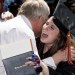 Female graduate hugging a well-wisher